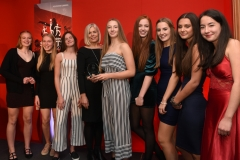 Caroline Rawlinson from Aspire presents the Junior Team of the Year award to Stroud High School U15 Handball team.