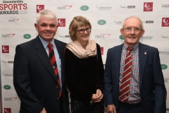 LtoR Stephen Ratcliffe, Ros Ratcliffe and David Evans. Gloucestershire Sports Awards 2018 Cheltenham Racecourse, Evesham Rd, Cheltenham.
